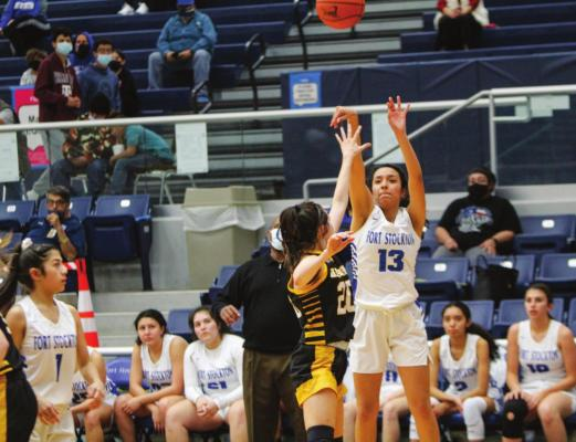 Fort Stockton junior Alyana Dominguez (13) takes a jump shot over Seminole's Londyn Shain during the second half of Tuesday's game at the Special Events Center. Photo by Nathan Heuer