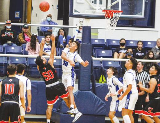 Fort Stockton's Ethan Acosta (30) blocks a shot during the second half of Tuesday's home game against McCamey. (Photo by Nathan Heuer)