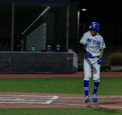 Fort Stockton's Adrian Hernandez tosses his bat towards the Panthers bench in joy after getting a walk due to being hit by a pitch during Tuesday's contest against Presidio.