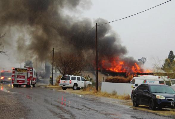 The Fort Stockton Fire Department works to put out a fire of a combined trailer at 227 Bishop St. in Fort Stockton around 2:30 p.m. on Wednesday Dec. 30. (Photo by Nathan Heuer)